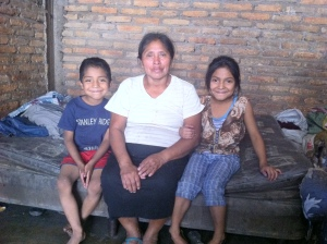 Angel (left) with his grandmother and sister in their small house he share with 17 people.