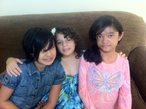 Larissa (right) with Katy and Karen, two of the girls that live in the orphanage with her.